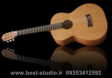 http://s5.picofile.com/file/8103746076/c1b56_classical_guitar1.jpg