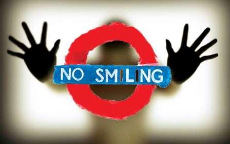 http://s5.picofile.com/file/8154551450/No_smiling.jpg