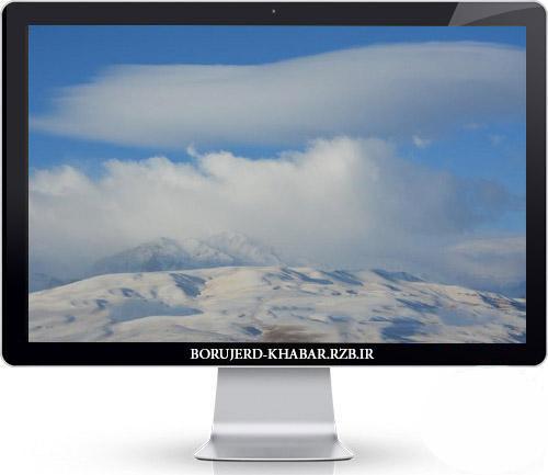 نمایی از کوه های پوشیده در برف بروجرد