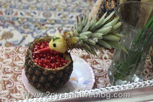 تزیین آناناس بشکل طوطی به عنوان ظرف انار